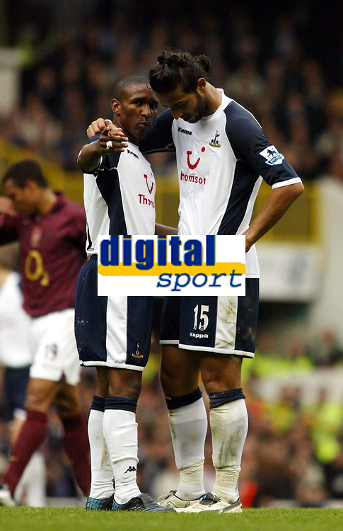Photo: Chris Ratcliffe.<br />Tottenham Hotspur v Arsenal. The Barclays Premiership.<br />29/10/2005.<br />Jermaine Defoe tries to point the way to Mido as the North London derby ends in a draw.
