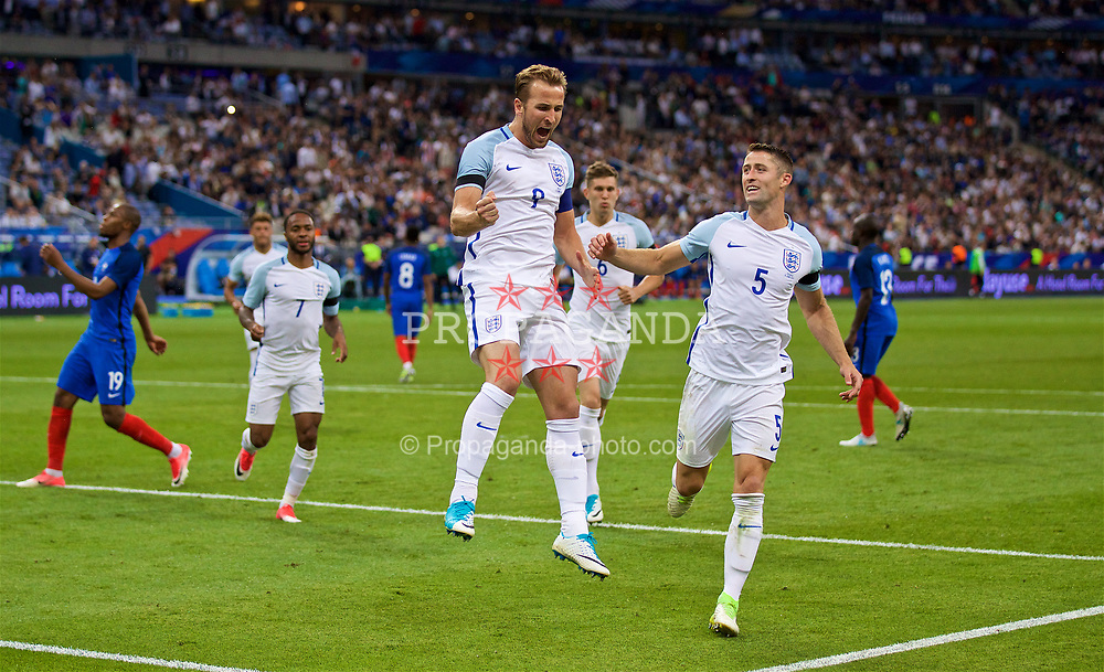 PARIS, FRANCE - Tuesday, June 13, 2017: England's captain Harry Kane celebrates scoring the second goal against France from the penalty spot during an international friendly match at the Stade de France. (Pic by David Rawcliffe/Propaganda)