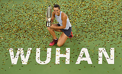 WUHAN, Sept. 30, 2017 Caroline Garcia of France poses with the trophy on the awarding ceremony after winning the singles final match against Ashleigh Barty of Australia at 2017 WTA Wuhan Open in Wuhan, capital of central China's Hubei Province, on Sept. 30, 2017. Caroline Garcia won 2-1. wdz) (Credit Image: © Ou Dongqu/Xinhua via ZUMA Wire)