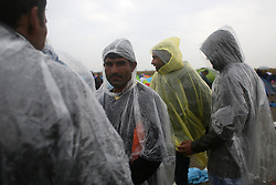 © London News Pictures. Migrants gather in a makeshift camp waiting to be taken to be processed close to the town of Roszke, Hungary, September 10 2015. As the EU struggles with a major migrant crisis, the European Commission has proposed that 120,000 additional asylum seekers should be shared out between members, using binding quotas.   Picture by Paul Hackett /LNP