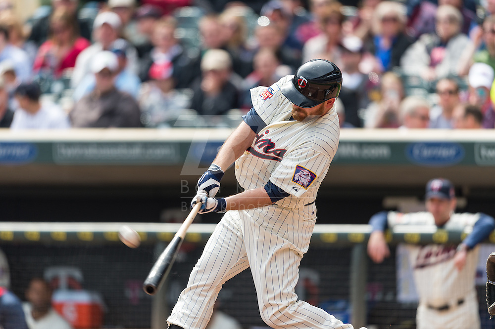 Jason Kubel #13 of the Minnesota Twins connects for a home run against the Oakland Athletics on April 9, 2014 at Target Field in Minneapolis, Minnesota.  The Athletics defeated the Twins 7 to 4.  Photo by Ben Krause