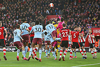 Football - 2019 / 2020 Premier League - Southampton vs. Aston Villa<br /> <br /> Southampton's Alex McCarthy punches clear from Pepe Reina of Aston Villa to set Saints on the attack to score at St Mary's Stadium Southampton<br /> <br /> COLORSPORT/SHAUN BOGGUST