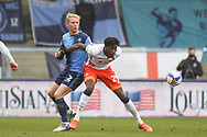 Luton Town forward Elijah Adebayo (29) battles for possession Wycombe Wanderers defender Jack Grimmer (2) during the EFL Sky Bet Championship match between Wycombe Wanderers and Luton Town at Adams Park, High Wycombe, England on 10 April 2021.