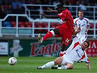 Photo: Daniel Hambury.Digitalsport<br /> Rushden & Diamonds v Swindon Town.  24/8/2004<br /> The Carling Cup<br /> <br /> Swindon Town's Lloyd Opera and Rushden & Diamonds'  Gary Mills