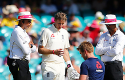 England's Joe Root after being struck on the hand during day four of the Ashes Test match at Sydney Cricket Ground.