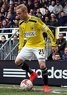Alex Pritchard dribbling, holding the ball in the corner during the Sky Bet Championship match between Fulham and Brentford at Craven Cottage, London, England on 3 April 2015. Photo by Matthew Redman.