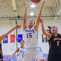 020315       Cable Hoover<br /> <br /> Miyamura Patriot Hannah Murphy (15) reaches between Gallup Bengals Shenoah Begay (22) and Rachelle Blackgoat (1) for a rebound Tuesday at Miyamura High School.