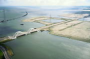 Nederland, Amsterdam, IJburg, 25-09-2002; Enneus Heermabrug verbindt eilanden van het nieuwe stadsdeel IJburg met de ringweg A10, links onder de afrit van de autosnelweg; hoogspanningsmasten in het Buiten-IJ, met in de verte het vuurtoren eiland bij Durgerdam; IJsselmeer, Zuiderzee, zand, landaanwinning, opspuiten, stadsvernieuwing, nieuwbouw, planologie, stedebouw, infrastructuur, zie ook andere (detail)foto's van deze lokatie; luchtfoto (toeslag), aerial photo (additional fee)<br /> foto /photo Siebe Swart