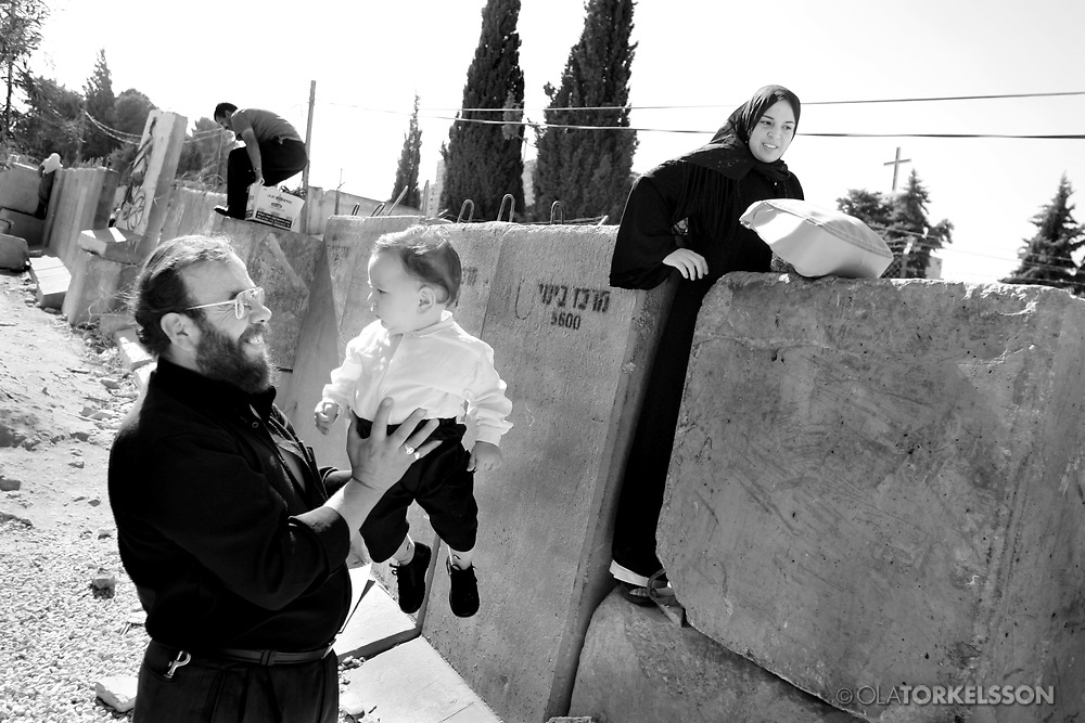 The wall in Abu Dis, West Bank.<br /> Photos from the building of the israel so called security barrier that cuts through the Palestinian village of Abu Dis. People climbing over the wall.