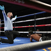 Ofacio Falcon knocks down Jonathan Gray during a One For All Promotions boxing event at the Caribe Royale Orlando Events Center on Saturday, February 20, 2021 in Orlando, Florida. (Alex Menendez via AP)