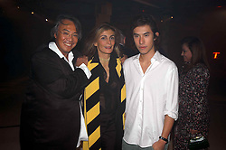 Left to right, DAVID TANG, MRS ROLF SACHS and EDWARD TANG at an exhibition of work by Rolf Sachs - a unique world-renowned contemporary furniture designer, held in association with the Louisa Guinness Gallery and held at 250 Brompron Road, London on 6th October 2004.<br />