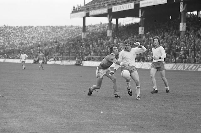 Tyrone attempts to kicks the ball towards the goal during the All Ireland Minor Gaelic Football Final, Tyrone v Kerry in Croke Park on the 28th September 1975.