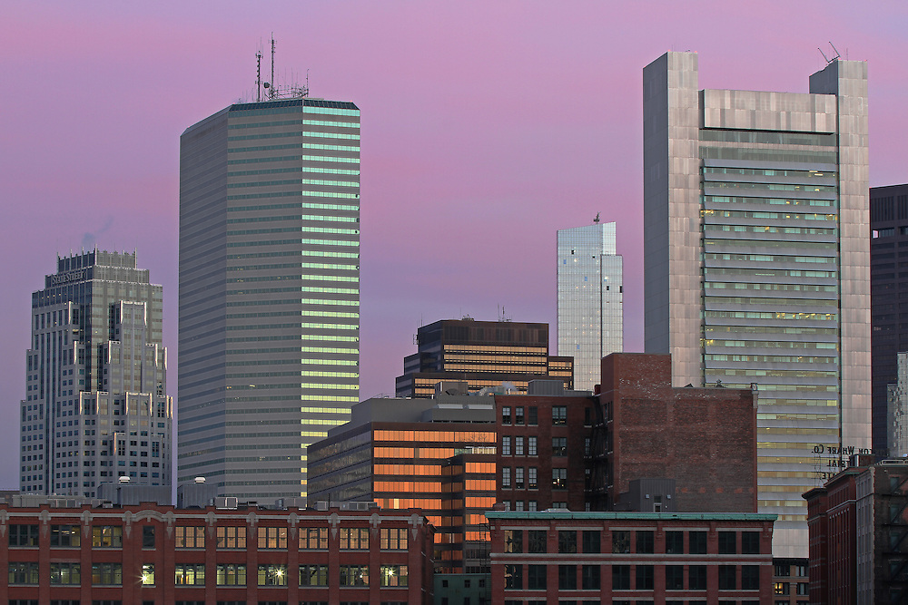 Boston skyline photography featuring iconic skyscrapers and some of the tallest buildings in Boston such as the Boston State Street Corporation, The Federal Reserve Bank of Boston, the Boston Millennium Tower and the One Financial Center at Dewey Square on a magnificent morning at dawn. This Boston skyline photograph at dawn is available as museum quality photography prints, canvas prints, acrylic prints or metal prints. Fine art prints may be framed and matted to the individual liking and decorating needs:<br />  <br /> http://juergen-roth.pixels.com/featured/boston-state-street-boston-fed-one-financial-center-and-millennium-tower-juergen-roth.html<br /> <br /> All photographs are available for digital and print image licensing at www.RothGalleries.com. Please contact me direct with any questions or request.<br /> <br /> Good light and happy photo making!<br /> <br /> My best,<br /> <br /> Juergen<br /> Prints: http://www.rothgalleries.com<br /> Photo Blog: http://whereintheworldisjuergen.blogspot.com<br /> Twitter: @NatureFineArt<br /> Instagram: https://www.instagram.com/rothgalleries<br /> Facebook: https://www.facebook.com/naturefineart