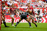 Hull FC hooker Danny Houghton (9) stops Wigan Warriors replacement Ryan Sutton (19)  during the Ladbrokes Challenge Cup Final 2017 match between Hull RFC and Wigan Warriors at Wembley Stadium, London, England on 26 August 2017. Photo by Simon Davies.