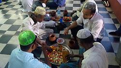 May 28, 2017 - Kolkata, India - Indian Muslim  at ifter at the first day of Ramadan at a city  masque on May 28,2017 in Kolkata,India. (Credit Image: © Debajyoti Chakraborty/NurPhoto via ZUMA Press)