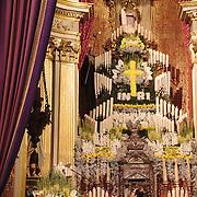 The Foot Washing mass at Braga's Cathedral, held on on Holy Thursday, during Semana Santa. Men lighting candles at the altar