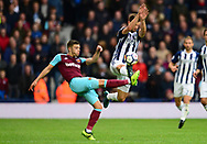 Jay Rodriguez of West Bromwich Albion attempts to block the ball from Aaron Creswell of West Ham United. Premier league match, West Bromwich Albion v West Ham United at the Hawthorns stadium in West Bromwich, Midlands on Saturday 16th September 2017. pic by Bradley Collyer, Andrew Orchard sports photography.