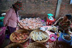 Buying Dried Fish At Market