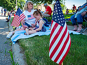 04 JULY 2020 - RUNNELLS, IOWA: People wait for the 4th of July tractor parade to start in Runnells, a small community about 25 miles from Des Moines. Most of the Independence Day parades in central Iowa were cancelled because of the COVID-19 (Coronavirus) pandemic. People in Runnells made the decision to go ahead with their parade, the first 4th of July parade in the town in recent memory. Most of the people in the parade were farmers, who drove their tractors through the town.     PHOTO BY JACK KURTZ