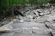 Bear Mountain, New York - A volunteer walks down the stairs on a newly rebuilt section of the Appalachian Trail during National Trails Day at Bear Mountain on June 5, 2010. A ceremony and hike celebrated the reconstruction of this original section of the Appalachian Trail. More than 800 volunteers, along with professionals, built 800 hand-hewn rock steps and a broad, gently sloping trail bed atop nearly a mile of rock wall.