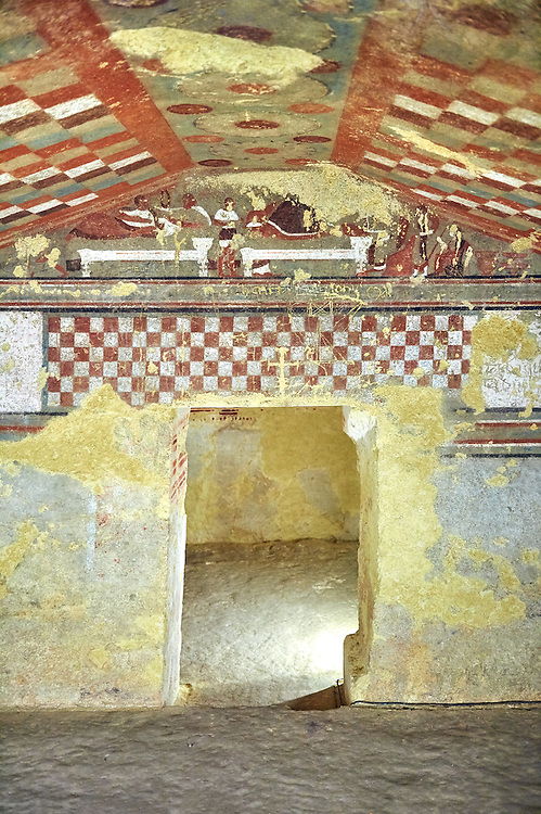 Underground Etruscan tomb  A single chamber with double sloping ceiling decorated with a painted chequered design, Etruscan Necropolis of Monterozzi, Monte del Calvario, Tarquinia, Italy. A UNESCO World Heritage Site. .<br /> <br /> Visit our ETRUSCAN PHOTO COLLECTIONS for more photos to buy as buy as wall art prints https://funkystock.photoshelter.com/gallery-collection/Pictures-Images-of-Etruscan-Historic-Sites-Art-Artefacts-Antiquities/C0000GgxRXWVMLyc
