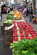 Market stalls selling fruits and vegetables: parsley, red bell peppers bellpeppers, apples, bananas etc Montevideo, Uruguay, South America