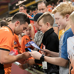 BRISBANE, AUSTRALIA - OCTOBER 7: Tommy Oar of the Roar signs autographs during the round 1 Hyundai A-League match between the Brisbane Roar and Melbourne Victory at Suncorp Stadium on October 7, 2016 in Brisbane, Australia. (Photo by Patrick Kearney/Brisbane Roar)