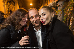 Francesco Pietrangeli of Metzeler with Ela Dutch (Emanuella Conti) of EICMA and Brazilian fashion photographer Monica Silva at a party at the Motosplash complex during EICMA, the largest international motorcycle exhibition in the world. Milan, Italy. November 21, 2015.  Photography ©2015 Michael Lichter.