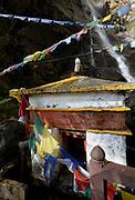 Water driven prayer wheel and prayer flads at the Paro Taktsang Goemba, monastery, know as the  Tigers Nest . Paro Taktsang Bhutan, Druk Yul. 11 November 2007