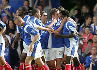Photo: Lee Earle.<br /> Portsmouth v Wigan Athletic. The Barclays Premiership. 09/09/2006. Portsmouth's Benjani (R) is congratulated after scoring the opening goal.