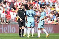 Craig Pawson, the referee, speaks to Fernandinho and Sergio Aguero ® of Manchester city. The Emirates FA Cup semi-final match, Arsenal v Manchester city at Wembley Stadium in London on Sunday 23rd April 2017.<br /> pic by Andrew Orchard,  Andrew Orchard sports photography.