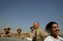 Alyaa Abdul Hassan Abbood, 23, a translator, waits with soldiers at the base of the 82nd Airborne to go to the local courthouse where they will give Iraqi civilians monetary compensation for damages caused by U.S. troops in Baghdad, Iraq, Sept. 27, 2003.