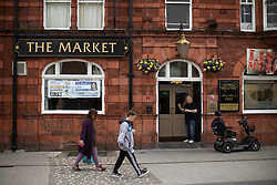 © Licensed to London News Pictures . 18/04/2019. Farnworth , UK . GV of The Market pub in Farnworth Town Centre , with Farnworth and Kearsley First poster in the window . Independent political parties , not tied to existing national parties , are competing for council seats in wards across the North West . Photo credit : Joel Goodman/LNP