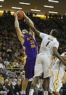 December 07 2010: Northern Iowa Panthers forward Lucas O'Rear (32) and Iowa Hawkeyes forward Melsahn Basabe (1) battle for a rebound during the first half of their NCAA basketball game at Carver-Hawkeye Arena in Iowa City, Iowa on December 7, 2010. Iowa defeated Northern Iowa 51-39.