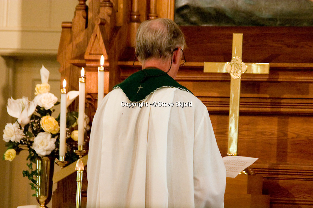 Minister praying and facing the altar. Vining Lutheran Church Vining Minnesota USA