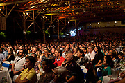 Families and crowd in VIP area, watching the music, Sergio Reys at Reponte da Cancao music festival and song competition in Sao Lorenzo do Sul, RIo Grande do Sul, Brazil.