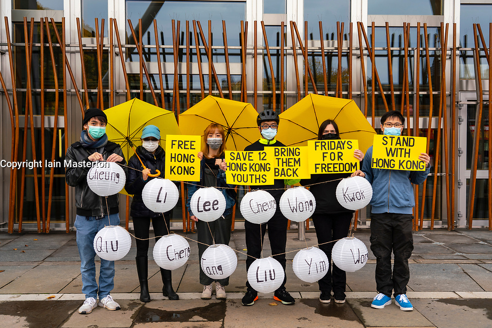 Edinburgh, Scotland, UK. 24 October 2020. Hong Kong pro democracy protesters stage demonstration outside Scottish Parliament building in Holyrood supporting 12 youths who were arrested by Chinese authorities whilst trying to sail to Taiwan to evade arrest under new national security laws in Hong Kong. The 12 youths have disappeared and have not been able to contact lawyers or families. Iain Masterton/Alamy Live News