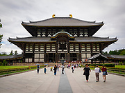 Historic Buddhist temple featuring a large Buddha statue & deer roaming the grounds.<br />