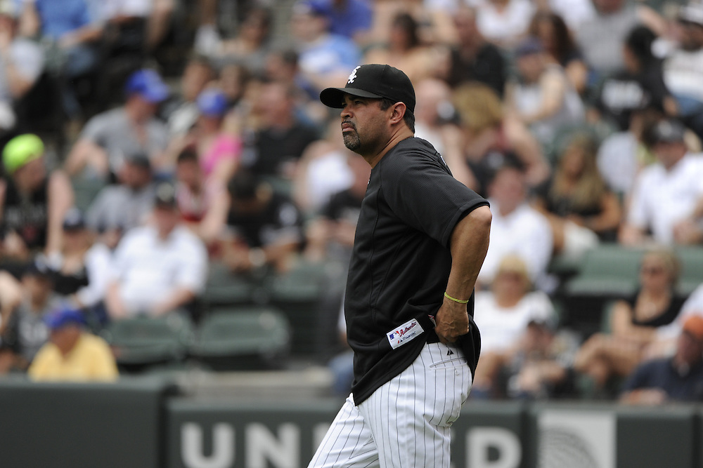 CHICAGO - MAY 22:  Manager Ozzie Guillen #13 of the Chicago White Sox makes a pitching change against the Los Angeles Dodgers on May 22, 2011 at U.S. Cellular Field in Chicago, Illinois.  The White Sox defeated the Dodgers 8-3.  (Photo by Ron Vesely)  Subject:   Ozzie Guillen