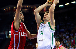 Hamed Ehadadi of Iran vs Gasper Vidmar of Slovenia during  the Preliminary Round - Group B basketball match between National teams of Slovenia and Iran at 2010 FIBA World Championships on September 2, 2010 at Abdi Ipekci Arena in Istanbul, Turkey. (Photo By Vid Ponikvar / Sportida.com)