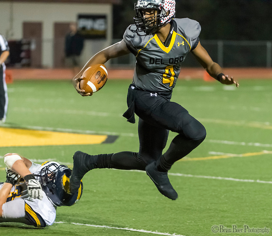 Del Oro Golden Eagle's Stone Smartt (4), runs with the ball during the second quarter as the Del Oro Golden Eagles varsity football team host the Oak Ridge Trojans, Friday Oct 21, 2016.<br /> photo by Brian Baer