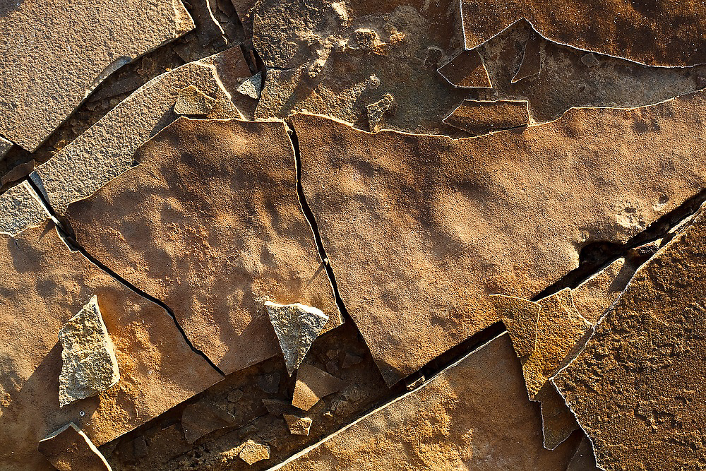 Detail of rock shards formed by frost heave, and rimmed with frost, on a cold clear morning in the badlands near Factory Butte, Utah.
