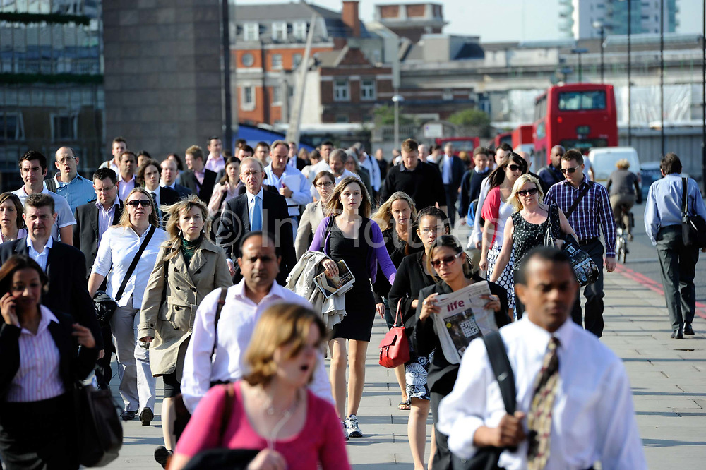 City workers make their early morning trek from the railway station across London Bridge to their offices in the heart of the 'square mile', London's financial centre.