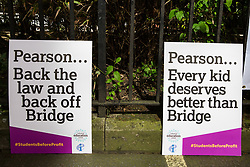 London, UK. 4th May, 2018. Placards used by members of the National Education Union (NEU) demonstrating outside the AGM of multinational assessment service Pearson in protest against investment by the corporation in 'low-fee' private schools provider Bridge. Bridge, one of the world's largest education-for-profit companies, aims to extend its influence throughout Africa and Asia.