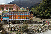 Indian truck drivers and their trucks, 19th October 2009, Himachal Pradesh, India. The trucks drive along roads in this area that are often precarious, with vehciles seen clinging to the edge with a sheer cliff drop on the side. The region of Spiti and Kinnaur is a remote and tribal area of the Indian Himalayas near the Tibetan border.