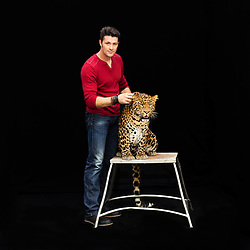 """Portrait of Alexander Lacey with his leopard Mogli. Alex travels with 19 lions and tigers, in addition to Mogli. """"I've been around animals since I was 4 years old – baby tigers, lions, chimps, bear cubs. My parents owned two zoos in England. [They] said to me, 'It's a way of life. It's not a job. We have to be here 365 days a year. Your life revolves around the animals.'""""<br /> <br /> After 146 years, the """"Greatest Show on Earth"""" will close its curtain in the end of May. <br /> Ringling Bros. and Barnum & Bailey Circus started in 1919 when the circus created by James Anthony Bailey and P. T. Barnum merged with the Ringling Brothers Circus. The circus' parent company, Feld Entertainment, made the decision to end the show after waning ticket sales and long court battles over the treatment of animals, particularly the elephants, made the costly entertainment event unsustainable."""