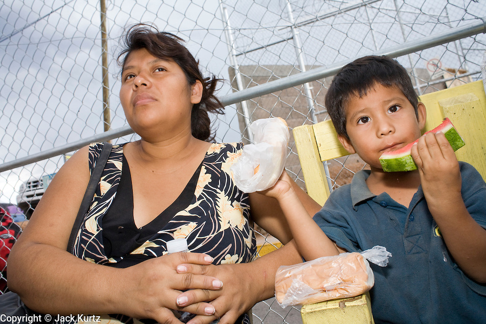 16 JULY 2007 -- NOGALES, SONORA, MEXICO: VIANES BELLO RODRIGUEZ, and her son MANUEL PATRON, 4, from the Mexican state of Guerrero, at the No More Deaths aid station near the Mexican port of entry in Nogales, Sonora, Mexico. They entered the US illegally Saturday and wandered through the desert Saturday and Sunday before being apprehended by the US Border Patrol Sunday night. They were trying to get to Indiana to be with her husband, Manuel's father. She is currently five months pregnant. No More Deaths and the Sonora state government set up the aid station in 2006 to help Mexican immigrants deported from the US from across the US Border Patrol station in Nogales, Arizona. Volunteers at the aid station provide immigrants, many of whom spend days in the desert before being apprehended by the US Border Patrol, with food and water and rudimentary first aid. The immigrants then go back to their homes in Mexico or into Nogales to make another effort at crossing the border. Volunteers said they help between 600 and 1,000 immigrants per day. The program costs about .60¢ per person to operate. So far this year they've helped more than 130,000 people.  Photo by Jack Kurtz