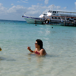 Tourists frolic on the beach of the Island of Mujeres off the Yucatan peninsula...Photo by Susana Raab