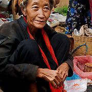 Seller smoking at Inle rural market