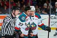 KELOWNA, CANADA - MARCH 3: Ted Brennan #10 speaks to Colum McGauley #23 of the Kelowna Rockets as he exits the ice after dropping the gloves with Riley McKay #27 of the Spokane Chiefs on March 3, 2018 at Prospera Place in Kelowna, British Columbia, Canada.  (Photo by Marissa Baecker/Shoot the Breeze)  *** Local Caption ***